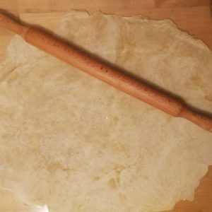 Step 3: Rolling out the dough/pastry. Don't worry about the rolling pin, any heavy cylindrical object will do, such as a glass bottle.